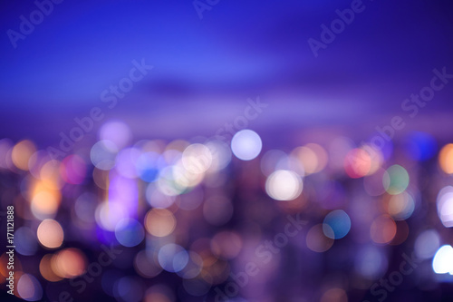 abstract blur and defocused cityscape at twilight for background, filter effect, sweet tone purple sky