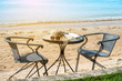 accessories for the holiday, sun glasses and hat sea, comfortable weave chair on the beach, copy space.