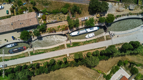 Fotobehang Kanaal Aerial top view of Fonserannes locks on canal du Midi from above, unesco heritage landmark in France