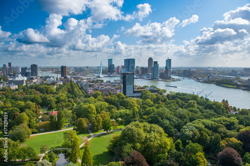 Photo Stands Rotterdam Rotterdam skyline with Erasmus bridge. Aerial view of Rotterdam, The Netherlands, Holland. A major logistic and economic centre, Rotterdam is Europe's largest port and has a population of 633,471.