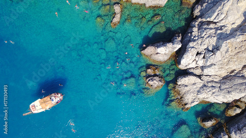 August 2017: Aerial drone photo of paradise beach of Traganou with small caves and turquoise clear waters, Rhodes island, Dodecanese, Aegean, Greece