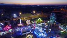 County Fair Rides Lights And Carnival Games At Sunset