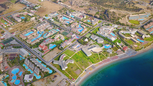 Fototapeta August 2017: Aerial drone photo of famous pools and 5 star resorts - hotels at small village of Kolympia bay, Rhodes island, Aegean, Dodecanese, Greece obraz na płótnie