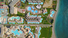 August 2017: Aerial Drone Photo Of Famous Pools And 5 Star Resorts - Hotels At Small Village Of Kolympia Bay, Rhodes Island, Aegean, Dodecanese, Greece