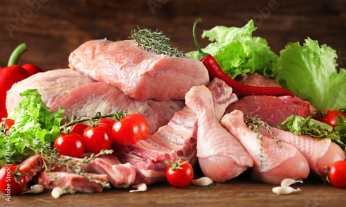 Staande foto Vlees Pieces of different fresh meat on kitchen table