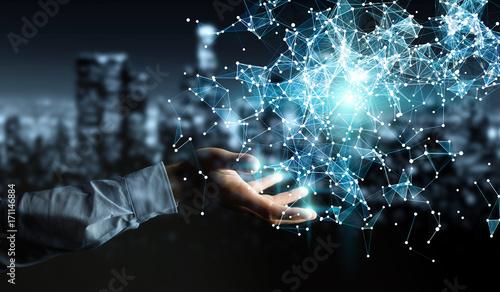 Fotografia  Businessman holding flying network connection 3D rendering