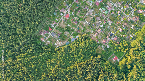 Poster Luchtfoto Aerial top view of residential area summer houses in forest from above, countryside real estate and small dacha village in Ukraine