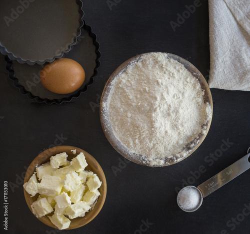 Fototapeta flour and ingredients on black table. Top view obraz na płótnie