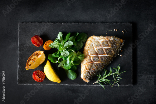 Fotografie, Obraz  Baked dorado with fresh salad and vegetables. Top view