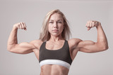 Beautiful athletic woman showing bicep muscles.