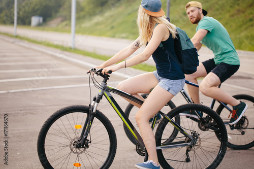 Deurstickers Fiets Side view of a middle aged man and woman biking road