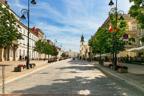 Fototapeta Warsaw, Poland - August 2, 2017: Architecture and people on the street New World in Warsaw. obraz