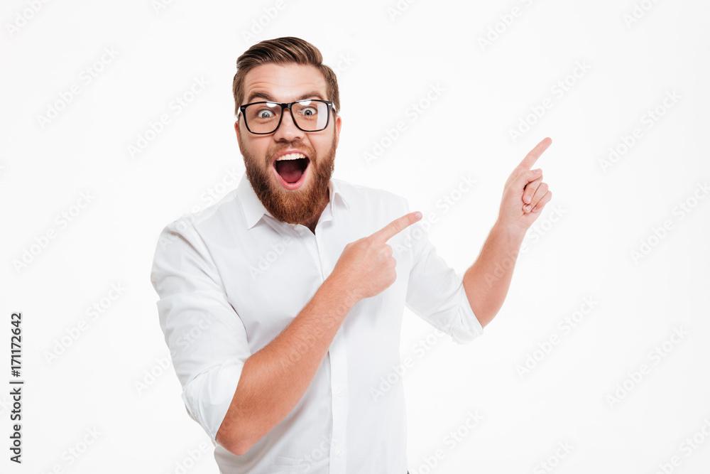 Fototapeta Happy excited bearded man in eyeglasses