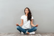 Leinwandbild Motiv Beautiful young asian woman sitting in yoga position and meditating