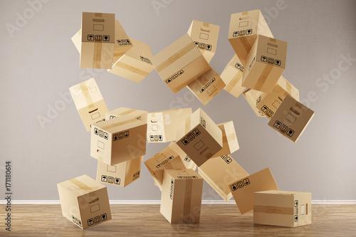 Fotografiet  Viele Umzugskartons fallen auf Boden