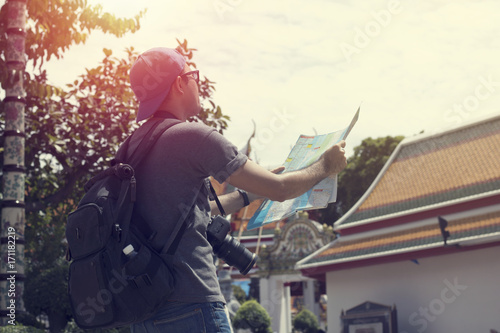 Canvas Prints Fishing Traveling Asian people looking on map and finding, famous place in Bankkok Thailand