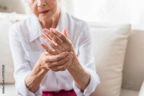 Elderly female is expressing pain Canvas Print