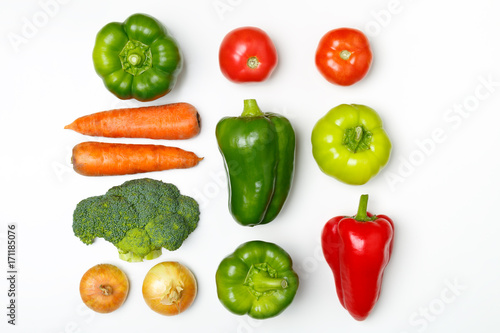 Top view of a set of seasonal vegetables on a white background.  The concept of a healthy diet. Fresh tomatoes, broccoli, carrots, peppers, onion