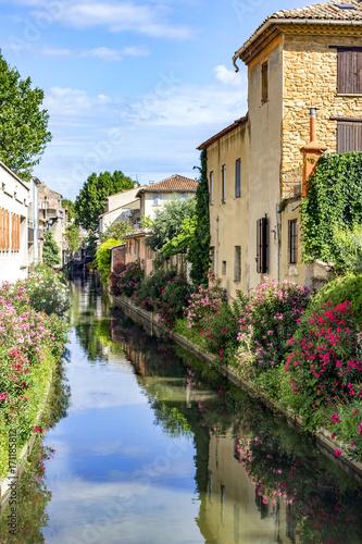 Fotografie, Obraz Water canal in orange town in southern France
