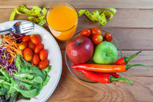 Fresh Healthy Salad With Different Fruits And Vegetables On Wooden Background