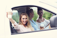 Young Women Traveling By Car W...