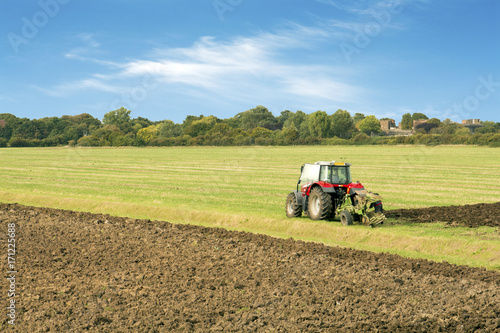 Photo  tractor ploughing a filed essex uk