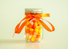 Mason Jar Filled With Candy Co...