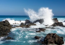 Ocean Waves Crashing Against Rocks At Hawaii Beach
