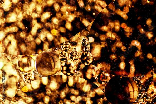 Printed kitchen splashbacks Beer / Cider Abstract gold bokeh light. Golden sparkles isolated on black background. Christmas template for design.