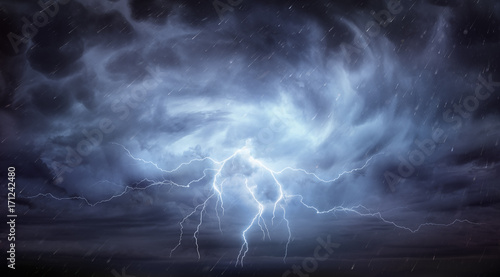Fotobehang Onweer Rain And Thunderstorm In Dramatic Sky