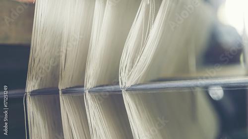 Fotografiet  old weaving loom - closeup - photo, vintage filter image