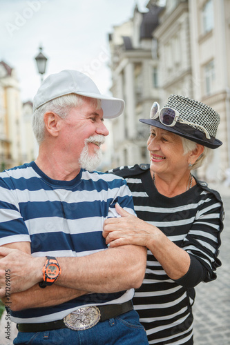 Fototapeta Happy mature man and woman leaned against each other. Mature man and woman smiling leaning against each other. obraz na płótnie