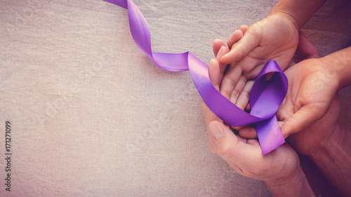 Hands holding Purple ribbons, toning copy space background, Alzheimer disease, P Canvas Print