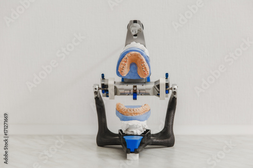 Articulator in a dental lab with open mold or artificial denture in dental lab o Fototapet