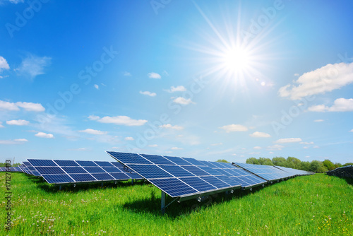 solar panel on blue sky background kaufen sie dieses foto und finden sie hnliche bilder auf. Black Bedroom Furniture Sets. Home Design Ideas