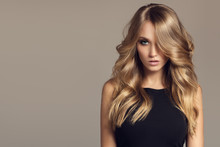 Blond Woman With Long Curly Be...