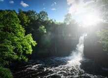 High Force Waterfall Views From The South Bank Of The River Tees On The Pennine Way In Woodland, UK.