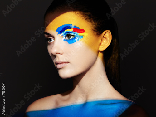 Fashion Model Woman With Colored Face Painted Beauty