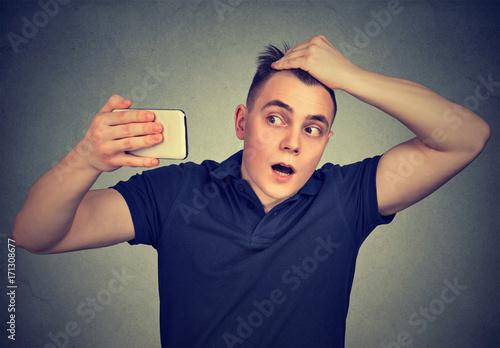 Fotografia, Obraz  shocked man feeling head, surprised he is losing hair