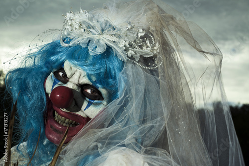 scary evil clown in a bride dress Canvas Print