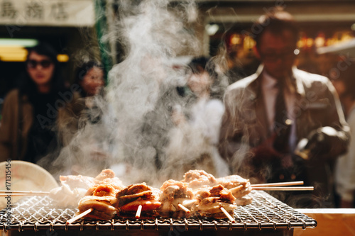 Fotografie, Obraz  grilled seafood scallop and sea ​​urchin eggs skewer with smoke, japanese street food at Tsukiji Fish Market, Japan