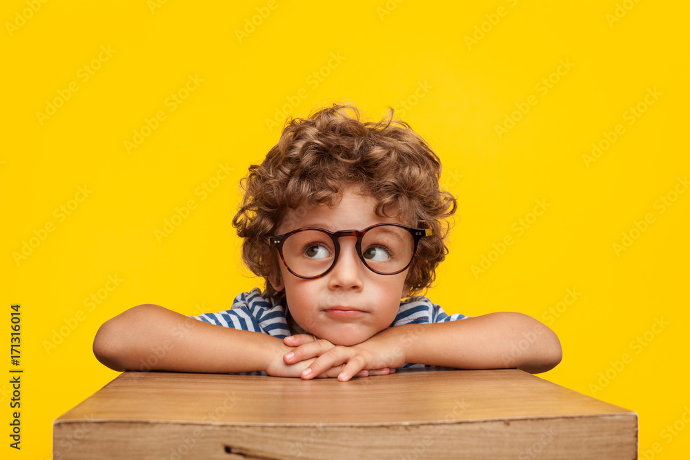 Fototapeta Pensive charming boy on studio background