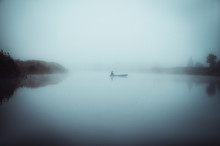 A Lonely Fishing Boat In The Fog