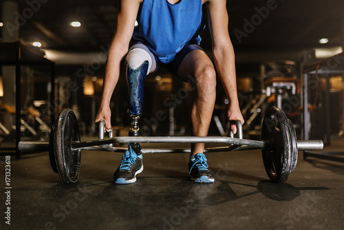 Disabled young man training in the gym. Canvas Print