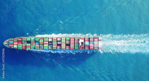 Fotografie, Obraz  Mega huge fully loaded container ship at sea aerial top down