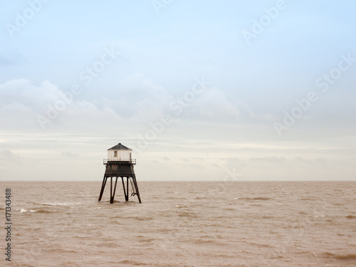 Photo  old sea structure light house Harwich sea bay beach