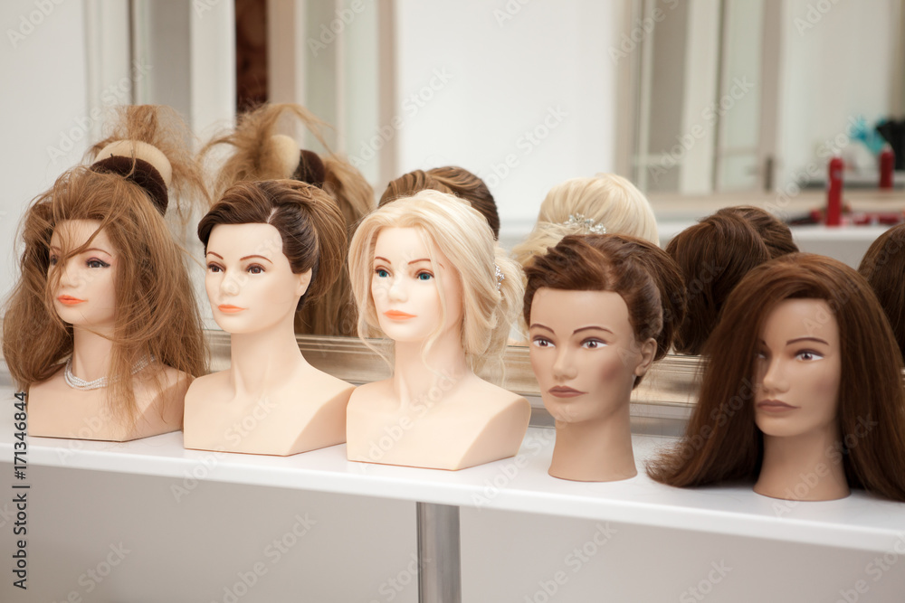 Fototapeta Different mannequin with different hairstyles on a stand. Dummy artificial model