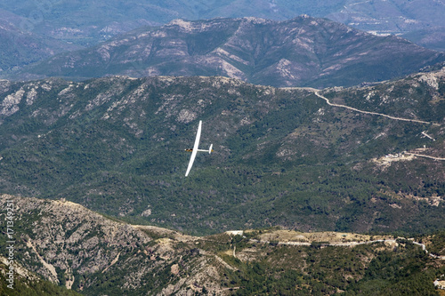 view of the sailplane flying over the mountains of Corsica