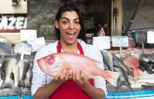 Laughing Woman Selling Fresh Fish On A Latin Fish Market