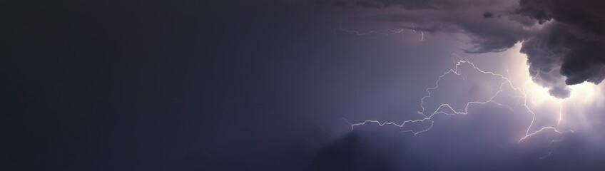 Huge lightnings and thunder during heavy summer storm.
